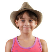 Smiling little girl in straw hat — Stock Photo