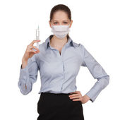 Woman in medical mask with syringe — Stock Photo