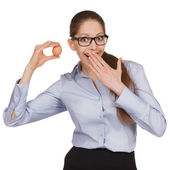 Surprised woman in glasses holding an egg — Stock Photo