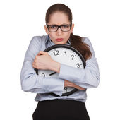 Sad woman with clock in hands — Stock Photo