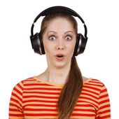 Surprised woman with headphones listening to the muse — Stock Photo