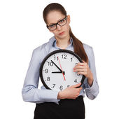 Sad girl with a big clock — Stock Photo