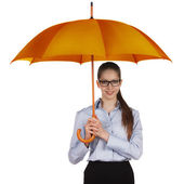 Happy woman standing under a large umbrella — Stock Photo