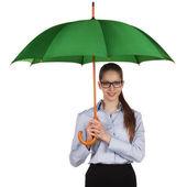 Happy girl standing under a umbrella — Stock Photo