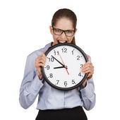 Girl in a state of stress bites the clock — Stock Photo