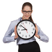 Woman in glasses holding big clock — Stock Photo