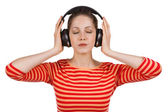 Girl, eyes closed, listening to music — Stock Photo