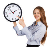 Girl shows on the round clock — Stockfoto