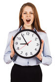 Yawning woman holding a large hours — Foto Stock