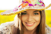 Happy woman in a wicker hat — Stock Photo