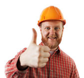 Man in a protective construction helmet — Stock Photo