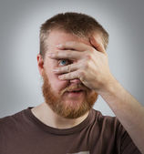 Man opened one eye and looks at us — Stock Photo