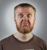 Red-beard man looking up with discontent — Stock Photo