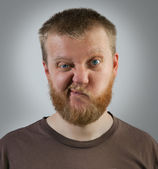 Man with an expression of discontent on his face — Stock Photo