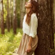 Woman leaning against birch and resting — Stock Photo #40971563