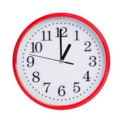 Round clock shows exactly one o'clock — Stockfoto