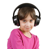 Girl listening to music on headphones — Stock Photo