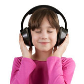 Girl having fun listening to music on headphones — Stock Photo