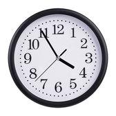 Horloge de bureau est à cinq minutes à quatre — Photo