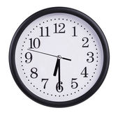 Round clock shows half of the seventh — Stock Photo