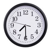 Round wall clock shows half past — Stock Photo