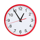 Almost an hour on a round clock face — Stock Photo