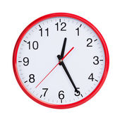 Round clock shows half of the first — Stock Photo