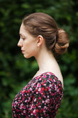 Profile of beautiful woman in a summer dress — Stock Photo