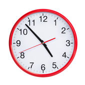 Nearly five on round clock face — Stock Photo