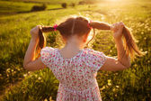 Little girl with tails of hair — Stock Photo