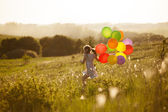 Happy little girl running across the field — Foto de Stock