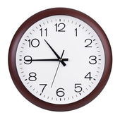 Quarter to eleven on the round clock — Stock Photo