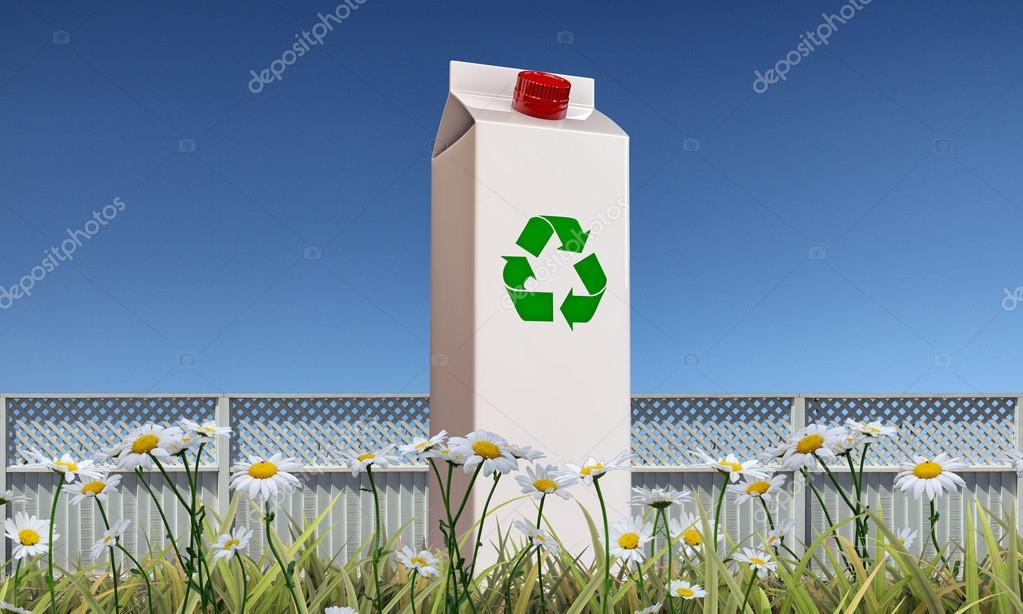 Milk package with recycle symbol on green grass — Stock Photo #14128256