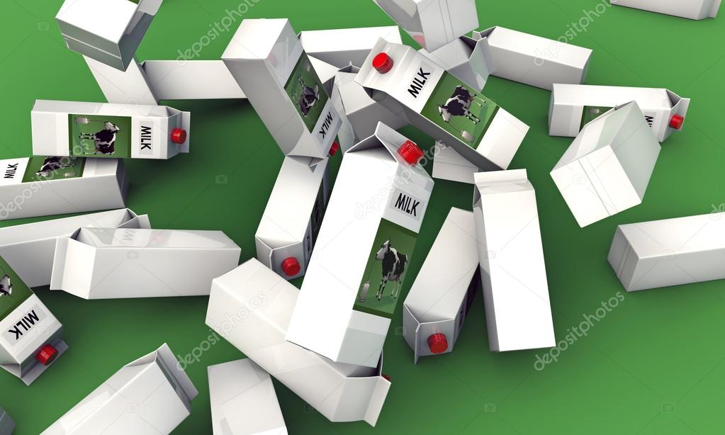 Milk packages falling down on green background — Zdjęcie stockowe #14128297