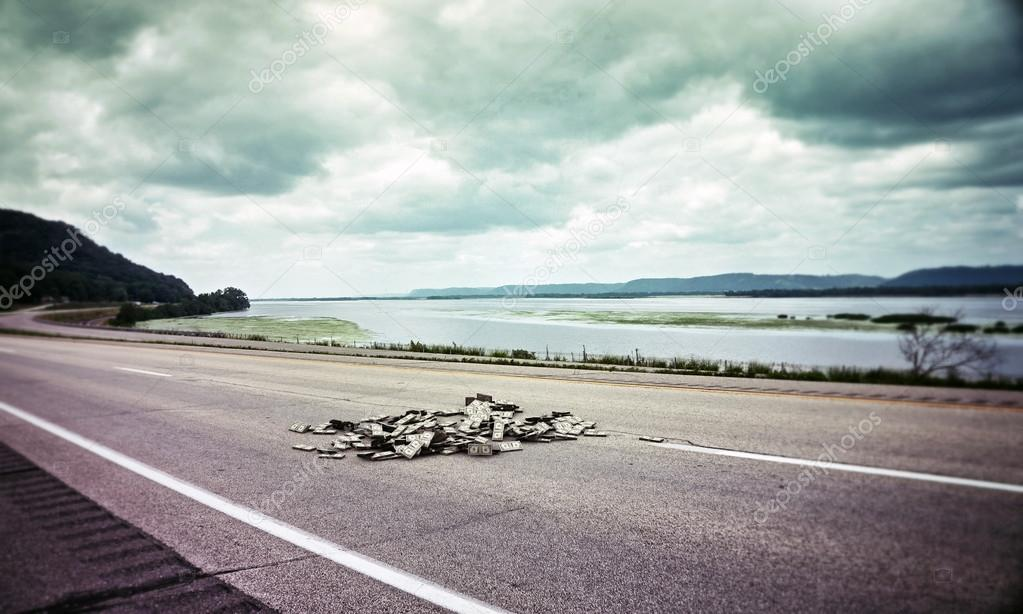 Dollar bills on a highway in old photo — Stock Photo #18283537