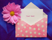 Envelope with a note — Stock Photo