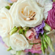 Bouquet of bride and rings — Stock Photo #22986990