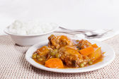 Chicken afritada with bowl of rice — Stock Photo