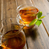 Black tea on wooden table — Stock Photo