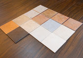 Some ceramic tiles on floorboard — Stock Photo