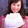 Asian girl at birthday party — Stock Photo