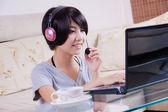 Young asian girl using laptop — Stock Photo