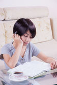 Young asian girl doing homework — Foto de Stock