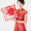 Постер, плакат: Chinese woman in cheongsam with traditional ornament