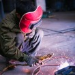 Stock Photo: Chinese worker welding metal