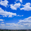 Cloudscapes above the city — Stock Photo