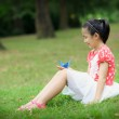 Little girl with paper crane — Stock Photo #25542421