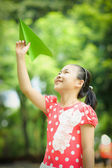Little girl with paper airplane — Stock Photo