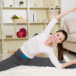 Chinese woman doing yoga — Stock Photo