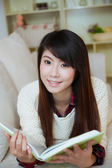 Young asian woman reading book — Stock Photo